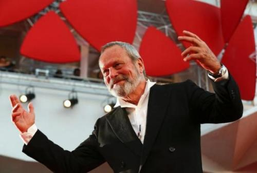 "Director Terry Gilliam gestures on the red carpet for his movie ""The Zero Theorem"" at the Venice Film Festival"